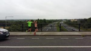 Stevey crossing a bridge over motorway